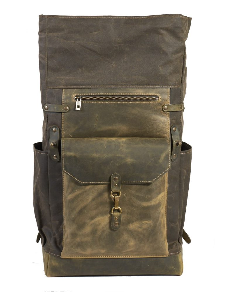dark olive waxed canvas leather travel rucksack. Leather pocket with snap hook closure