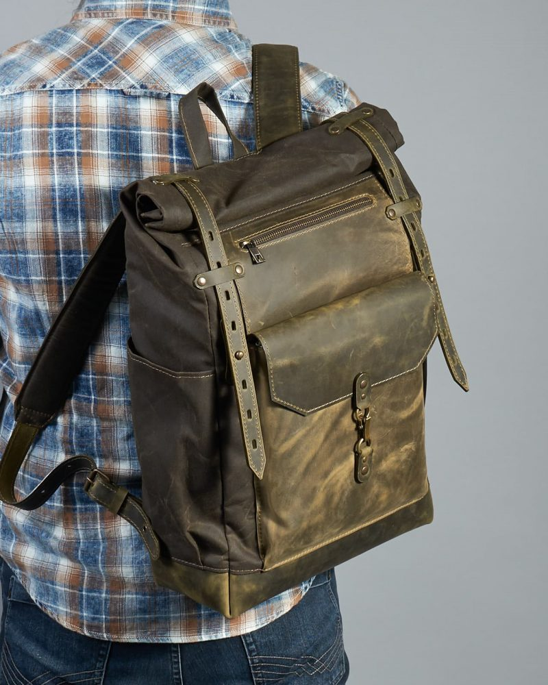 dark olive waxed canvas leather rucksack. Leather pocket with snap hook closure