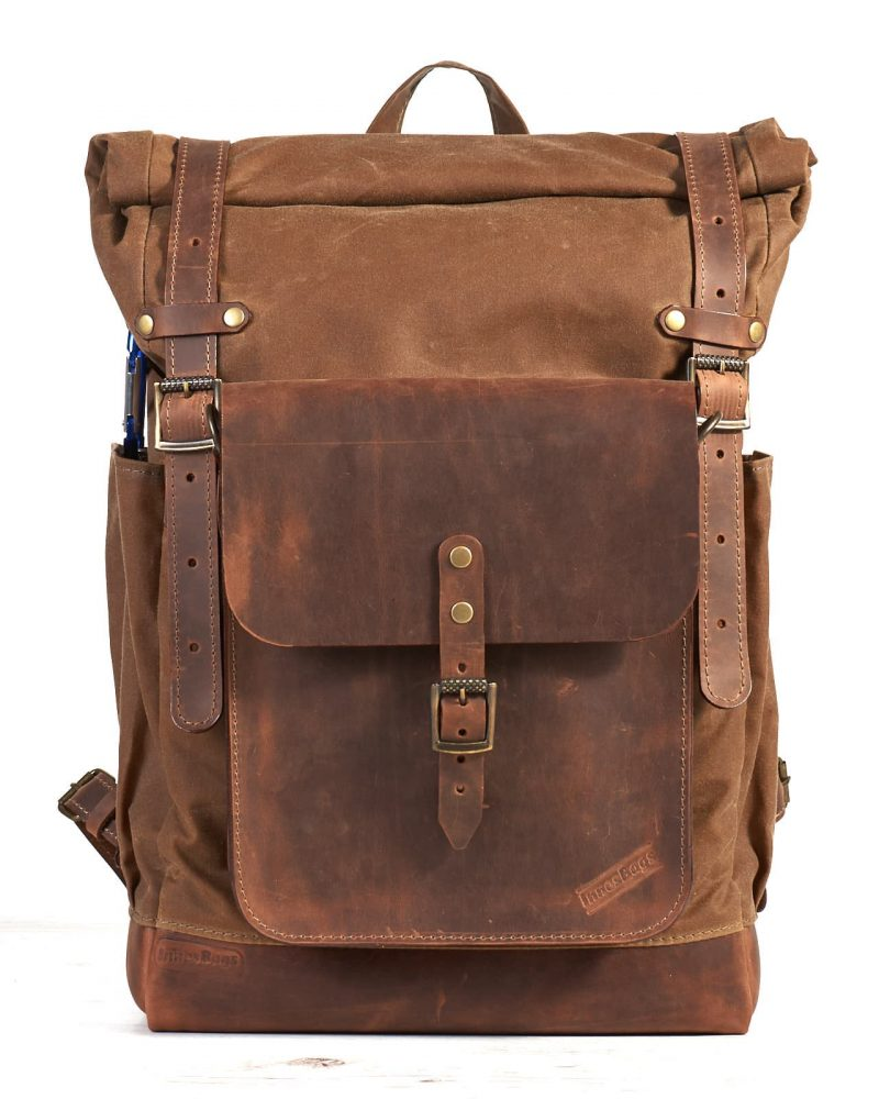 Tan waxed canvas roll top molle backpack with leather crossbody bag