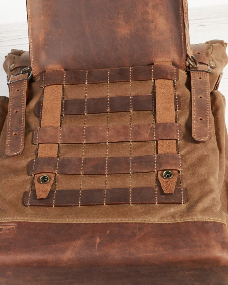 Tan waxed canvas roll top backpack with pals grid