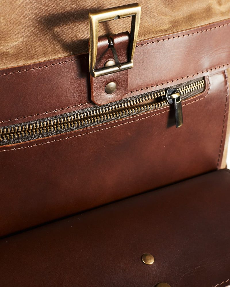top pocket. tan waxed canvas roll top city backpack