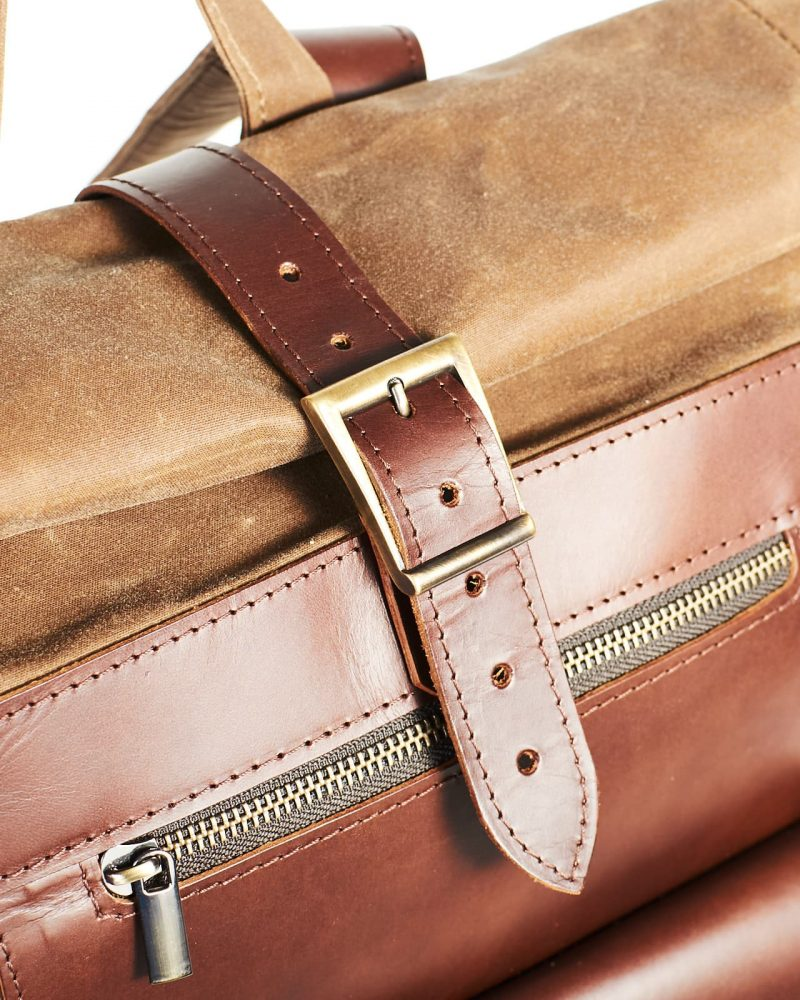 Buckle closure. Tan waxed canvas roll top city backpack
