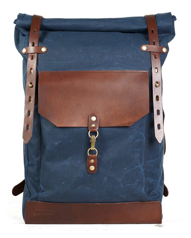 navy blue waxed canavs roll top backpack