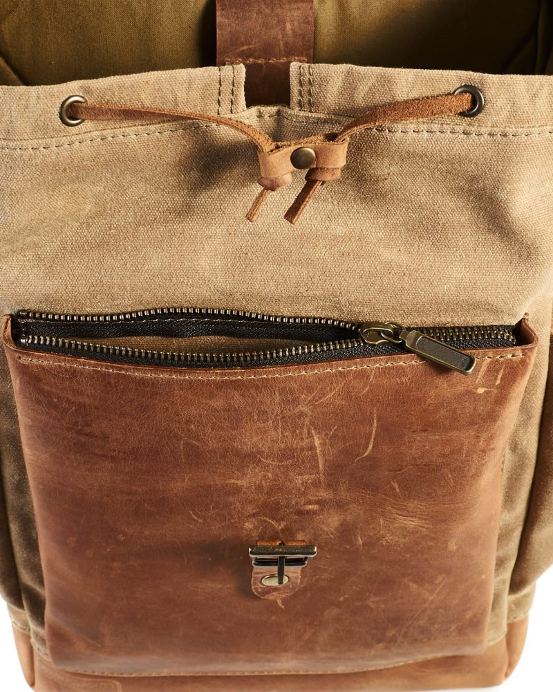 Sage timber waxed canvas backpack with leather flap and pocket