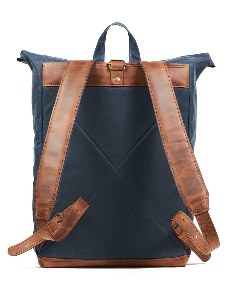 Navy blue waxed canvas leather roll top backpack. One hook closure