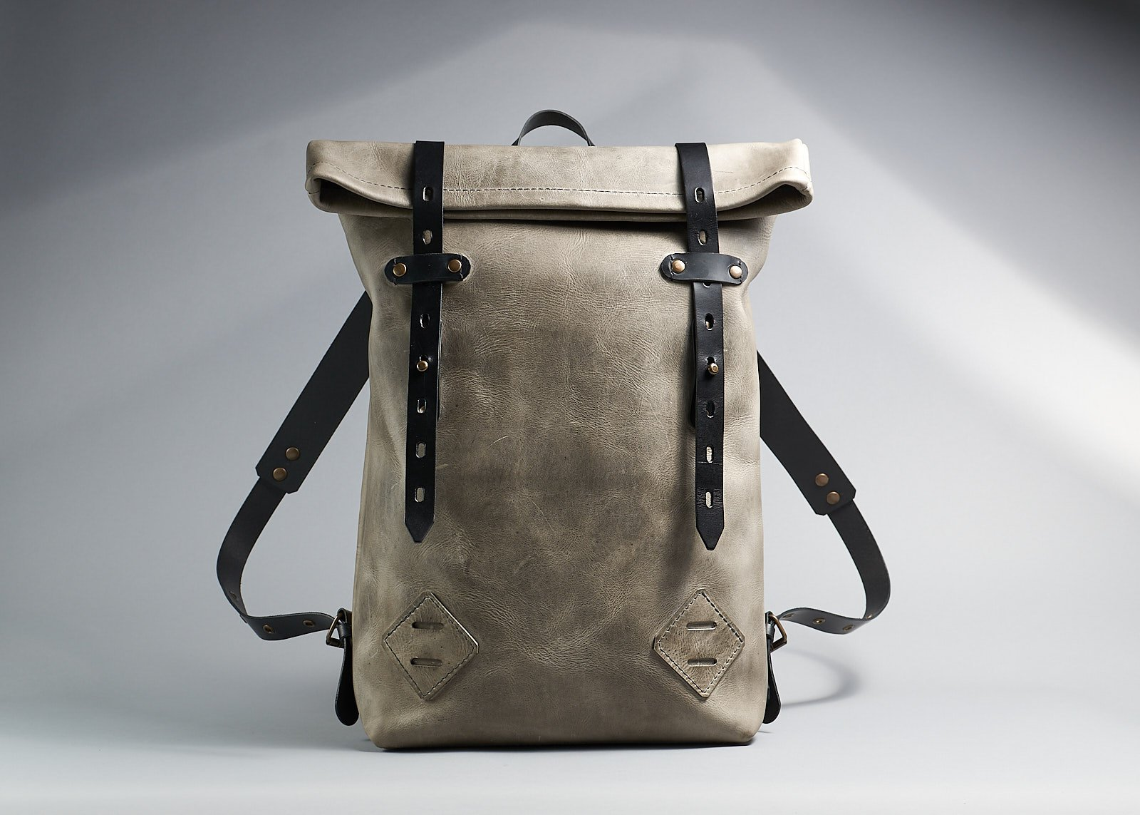 The minimalist unisex leather roll rop rucksack