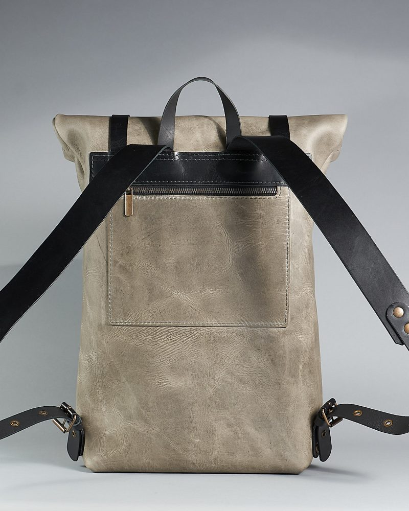 Leather roll top backpack with a secured back pocket